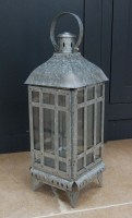 Galvanised steel lantern for use indoors and outdoors.